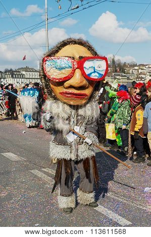 Person takes part in the parade at Lucerne carnival in Lucerne, Switzerland.
