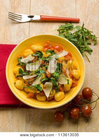 gnocchi with arugula tomato and parmesan cheese