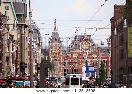 Amsterdam, The Netherlands - August 19, 2015: View On Amsterdam Central Station From Damrak Street W