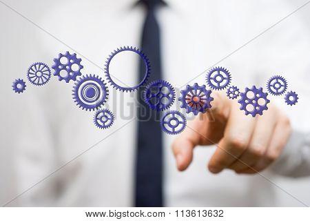 Businessman Touching Virtual Gearwheel, Concept Of .entrepreneurship Innovation