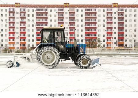 Blue Tractor Cleans Snow