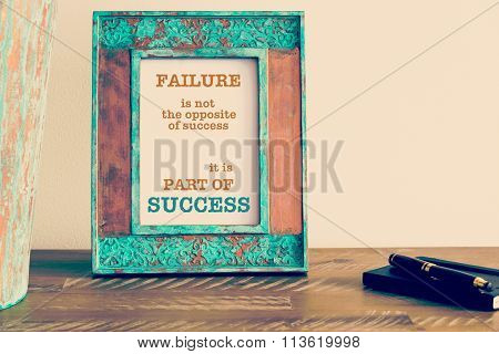 Motivational Quote Written On Vintage Photo Frame Failure Is Part Of Success