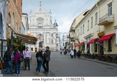 Tourists On Street Ausros Vartai Near Church Of St. Theresa