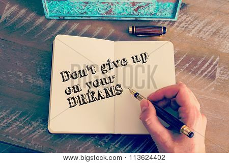 Motivational Message Don't Give Up On Your Dreams Written On Notebook