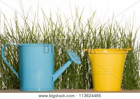 Blue Watering Can And Yellow Bucket