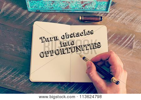 Motivational Message Turn Obstacles Into Opportunities Written On Notebook
