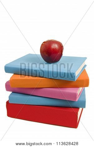 Unevenly Stacked Blank Books And Apple