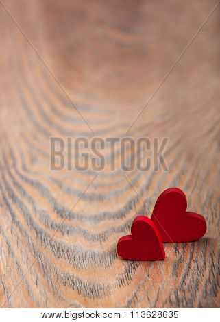 Hearts On A Wooden Background