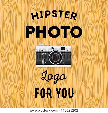 Hipster Logotype With Old Camera For Studio Or Photographer On Wooden Background