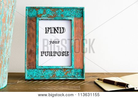 Vintage Photo Frame On Wooden Table With Text Find Your Purpose