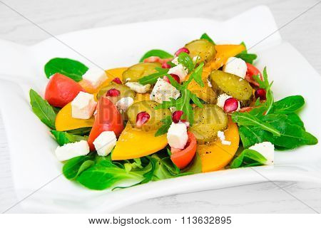 Healthy and Diet Food: Salad, Persimmon, Pickled Cucumber, Tomat