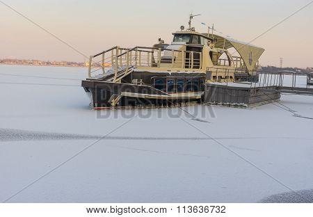 Pleasure boat frozen in on a Dnepr river