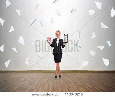Woman Holding Sandglass And Alarm Clock