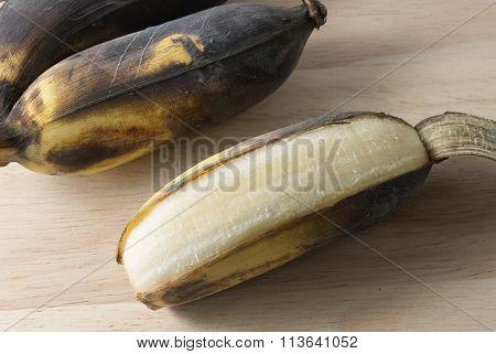 Open Old Banana Fruit On Wooden Board