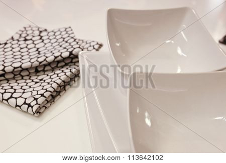White Porcelain Bowls And Plates With Napkin