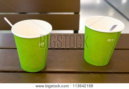 Empty Disposable Coffee Cups On Wooden Table