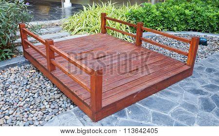 Brown Wooden Foot Bridge In A Park