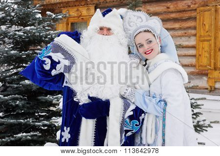 Russian Christmas Characters: Ded Moroz (father Frost) And Snegurochka (snow Maiden) Near A Russian