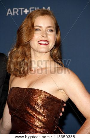 Amy Adams at the LACMA 2013 Art + Film Gala Honoring Martin Scorsese And David Hockney Presented By Gucci held at the LACMA in Los Angeles, USA on November 2, 2013.