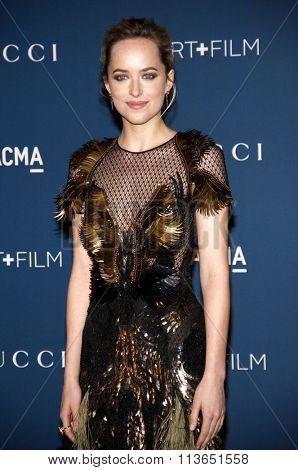 Dakota Johnson at the LACMA 2013 Art + Film Gala Honoring Martin Scorsese And David Hockney Presented By Gucci held at the LACMA in Los Angeles, USA on November 2, 2013.