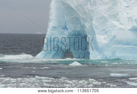 Blue Glacial Iceberg In Antarctica