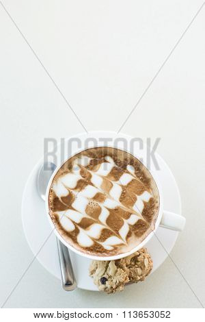 A Cup Of Coffee In A White Cup On Mable Table