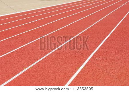 red plastic tracks on the sport field