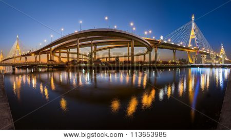 Panorama view of Twin Suspension Bridge and Industrial ring road with water reflection during twilig