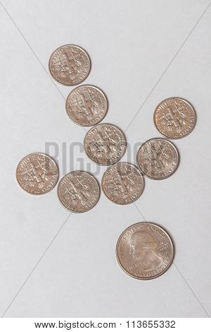 Coins in an Arrow Pattern Pointing at a Quarter