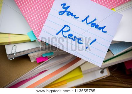Need Rest; The Pile Of Business Documents On The Desk