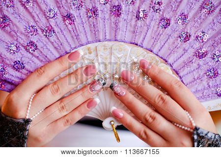 Wedding Fan Purple Color In The Hands Of The Bride