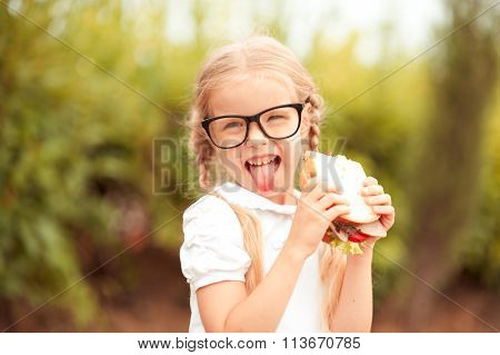 Girl eating outdoors