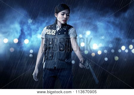 Beautiful Police Woman Holding Gun