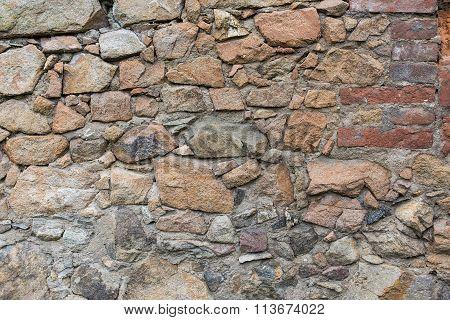 Stone wall with bricks