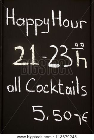 Blackboard With Happy Hour Announcement In Nuremberg, Germany, 2015