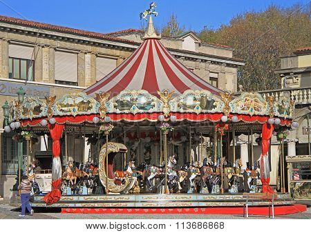 people are preparing to ride a horse on the carousel in Bergamo
