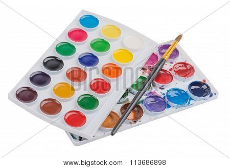 Watercolor paints in palette with the brush for drawing