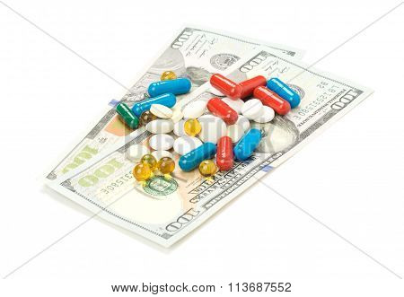 One hundred dollars banknotes and pill isolated on white background