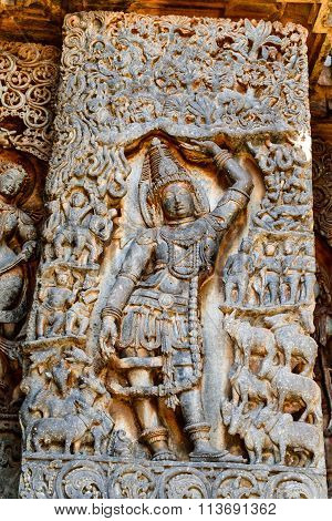 Artistic sculptures Lord Krishna on the walls of Hoysaleswara temple at Halebidu, Karnataka