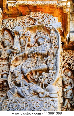 Artistic sculptures Lord Shiva on the walls of Hoysaleswara temple at Halebidu, Karnataka