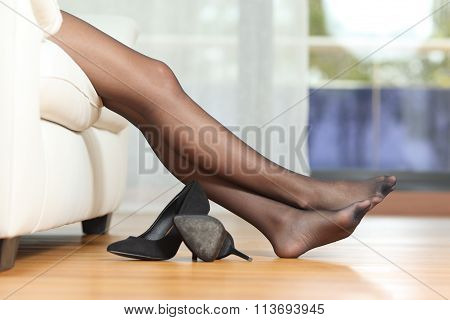 Tired Woman Legs Resting On Couch