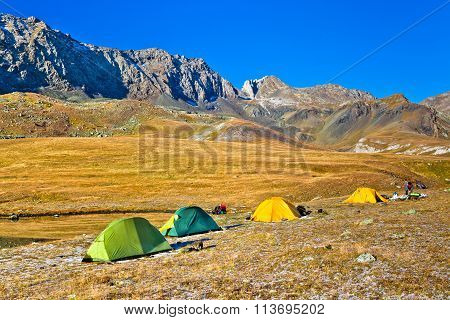 Trekking Tourists Camp In The Mountains In Autumn