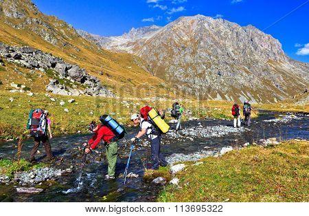 Tourists Overcome A Mountain River