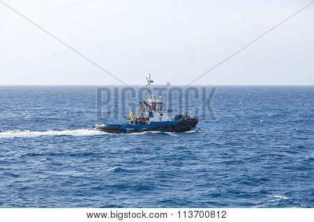 Blue Tugboat At Sea