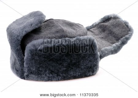 Russian Fur Hat With Ear-flaps Isolated