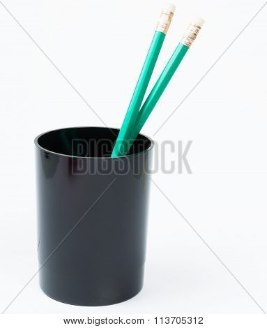 Green Pencil In The Black Holder