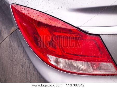 Car Taillight In Raindrops And Dirt