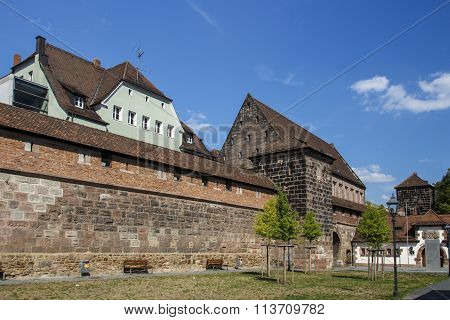 NUREMBERG, GERMANY - AUGUST 23, 2015: The city walls of the old town of Nuremberg in the southern area (Frauentormauer along the Frauentorgraben)