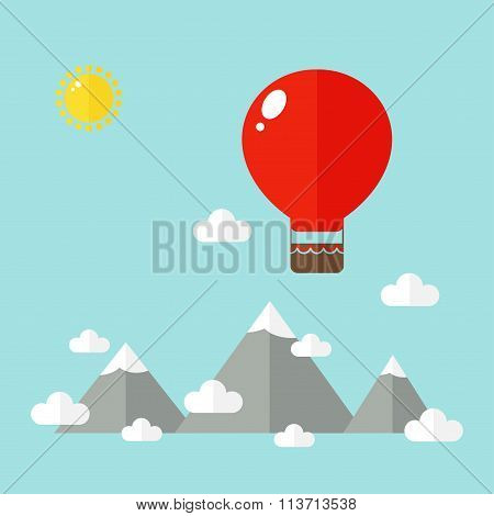 Mountains landscape with big air balloon.