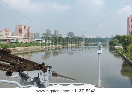 machine gun on the ship Pueblo in background Pyongyang